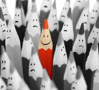 One bright color smiling pencil among bunch of gray sad pencils
