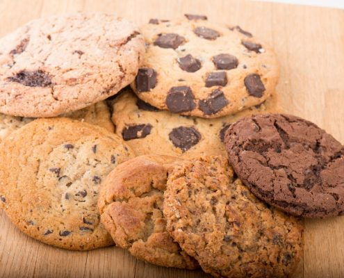 Tasty Pastry Cookies: 8 different types of cookies assorted on a wooden surface
