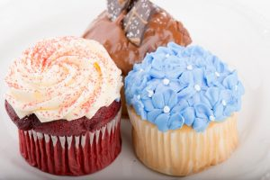 Tasty Pastry Tasty Treats: 3 Flavors of Cupcakes topped with icing