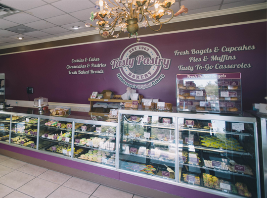 Tasty Pastry Interior of Shop showing display cases with a wide variety of baked goods