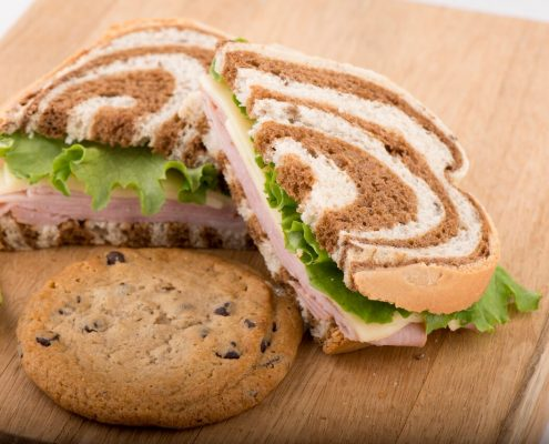 Tasty Pastry Take Home Meals: Sandwich with lettuce, meat & cheese on marble rye & a cookie